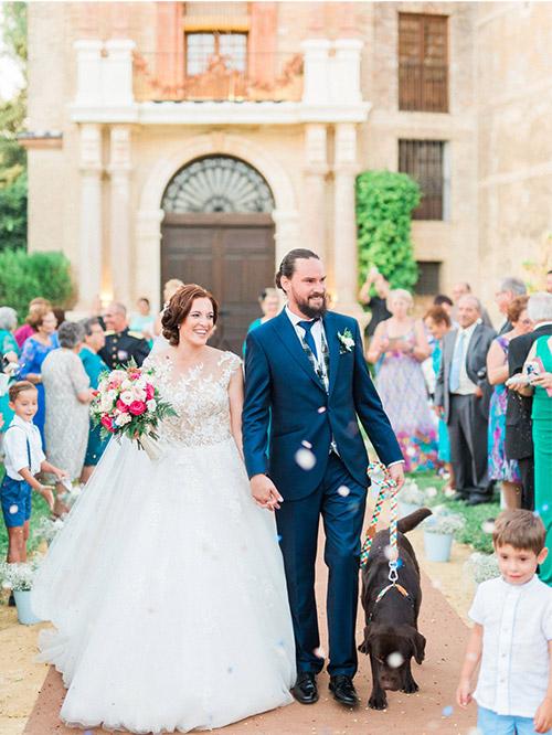 Fine Art Wedding Photographer in Seville. Bride and Groom and Dog in Castillo de la Monclova Wedding