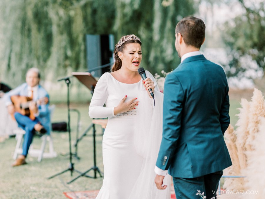 Bride Singing in Outdoor Sunset Wedding Ceremony in Seville