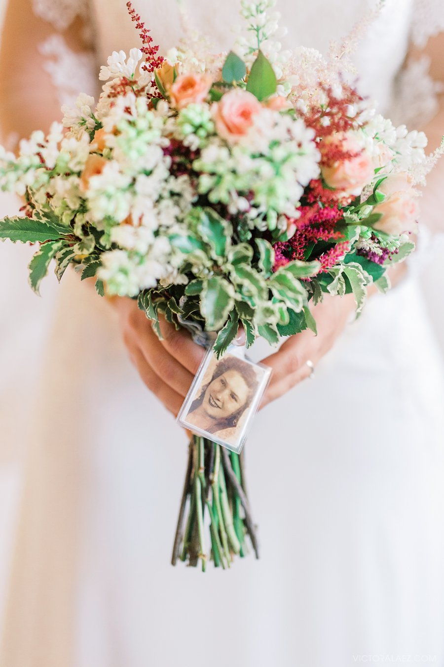 Beautiful Bridal Bouquet with a Photo of a Relative to Honor her Memory. Emotive detail