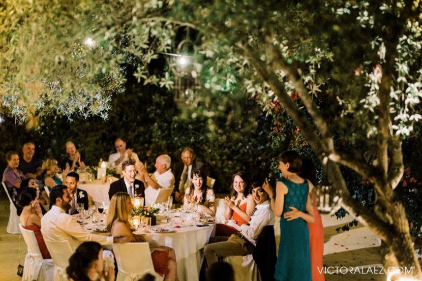 Mom Speech Reading in an Outdoor Wedding Reception at Night
